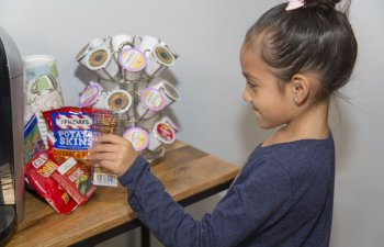 little girl choosing snacks from snack bar at Smile Structure Dentistry & Braces San Antonio, TX