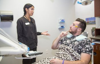 man in dental chair talking to dentist at Smile Structure Dentistry & Braces San Antonio, TX