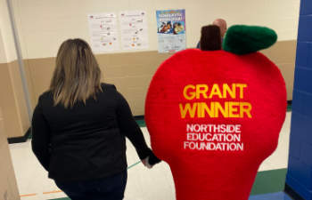 Smile Structure Dentistry & Braces as the Northside Education Foundation (NEF) Grant Patrol visiting school